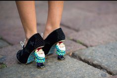 Seriously! That's crazy but pretty funny. I probably wouldn't stop laughing if I was walking down the street and saw a woman in a business suit and heels and then noticed that the heels were gnomes. Haha!! Gnome heels!