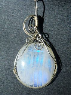Moonstone in sterling silver wire wrapped pendant, necklace..