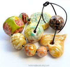 Porcelain, clay and lampwork bead set via trollsmedbeads on Etsy by artist Lise Trollsmed Nilsen of Norway.