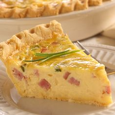 Great Quiche, geat with other fillings or cheeses. Had it with Bacon, Asparagus and Cheddar, it was awesome!