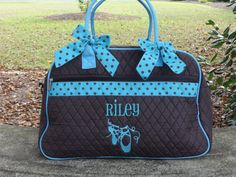 This is a Brown and Turquoise quilted duffle bag with removable bows. This  bag has fdeb7c229f