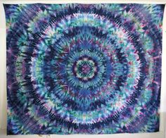 King sized hand ice dyed psychedelic mandala wall hanging.  Perfect for home or apartment, decorating a yoga studio, window covering, backdrop for photography or musical performances, even a blanket to sit on for concerts or the beach. This unique tapestry has small loops on all four corners, making it easier to hang. This cotton tapestry is also 3D, one pair of 3D glasses is included with purchase.  **MEASUREMENTS**  Length 100 Width 85   100% Cotton Machine wash cold water hang dry  I work…