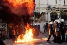 Clean Up Begins In Athens As EU Commissioner Rehn Welcomes Greek Austerity Vote.