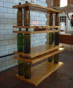 Shelves from reclaimed wood and wine bottles.  This would be cool with LED Christmas lights in the bottles.