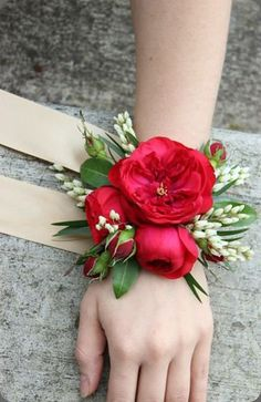 As gorgeous as a lush bouquet of flowers is, not every bride wants to carry one. As gorgeous as a Red Corsages, Prom Corsage And Boutonniere, Bridesmaid Corsage, Flower Corsage, Corsage Wedding, Wedding Bouquets, Boutonnieres, Prom Wrist Corsage, Bridesmaids