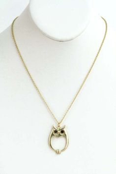 Cut Out Owl Necklace in Gold. I found this on www.maynovember.com