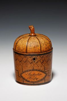 "Rare fruit tea caddy    A very unusual and rare continental fruit tea caddy in the form of a melon within a woven basket, the fruit of the basket inscribed ""Andenken V Baden"" - ""Souvenir from Baden"". Richard Gardner Antiques"