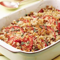 A gratin is any dish topped with cheese or breadcrumbs mixed with butter, then heated until browned - but it needn't be heavy. This one has plenty of garden-fresh tomatoes and herbs, a touch of full-flavored cheese and a crispy crumb topping.