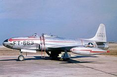 A USAF Lockheed F-80B Shooting Star of the 22nd Fighter Squadron sits on the ramp ready to go.