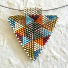 TriangleScape Pendants Quilts by BeadJewelryShopgirl on Etsy Triangle Pattern, Peyote Patterns, Beading Patterns, Beaded Earrings, Beaded Jewelry, Art Perle, Peyote Beading, Peyote Stitch, Line Art