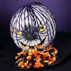 Petrifying Pumpkin Candy Dish  Creep out all your Halloween guests with this candy-spewing pumpkin!  This pumpkin candy dish is a surefire way to scare up some Halloween fun using creativity Fill with treats for a sweet and scary way to greet all the little ghosts and goblins.