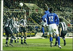 6 November 2002 Kevin Campbell peels off his marker to meet a perfectly flighted corner from Mark Pembridge and head home during a Worthington Cup tie at Newcastle