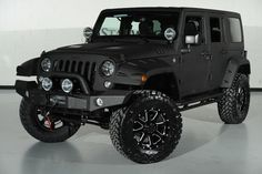 Custom Black Kevlar Coated 2014 Jeep Wrangler Unlimited: Front-Left View