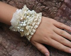 Wrist wrap combines delicate with bold/rustic. Charming little bracelet in shades white is made of delicious antique laces--bobbin laces, lingerie