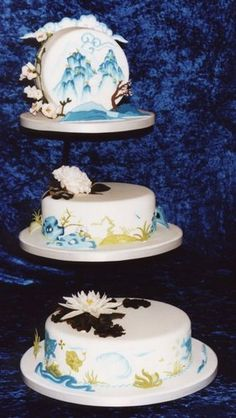 A striking three tiered wedding cake in a chinese blue and white style and representing earth, water and sky. Description from twinmoons.org.uk. I searched for this on bing.com/images