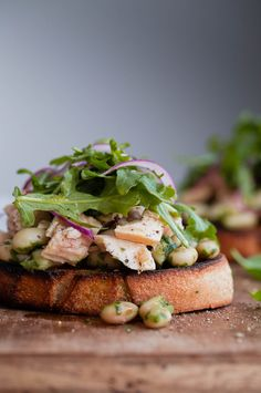 Mediterranean Tuna Tartines - a modern, fresh Italian tuna sandwich made with pesto cannellini beans, extra virgin olive oil packed tuna, and arugula!