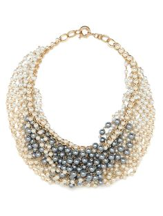 This is going to be one of those must-have statement necklaces. It's an audacious bib style crafted from a marvelous mesh web of pearls, both in lustrous white and cool gray.
