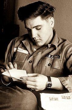 Elvis reading fan mail in 1958
