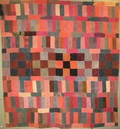 From Laura Fisher Quilts - Strip Bars and Nine Patch Antique Quilt (pieced of corduroy and velvet in strips)