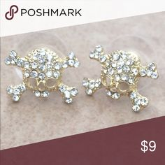 Gold Tone Crystal Open Skull Skeleton Stud Earring Gold tone stud earrings features an open skull and crossbones design with clear crystals with posts and friction backs.  Measures 3/8 inch L x 1/2 inch W. Jewelry Earrings