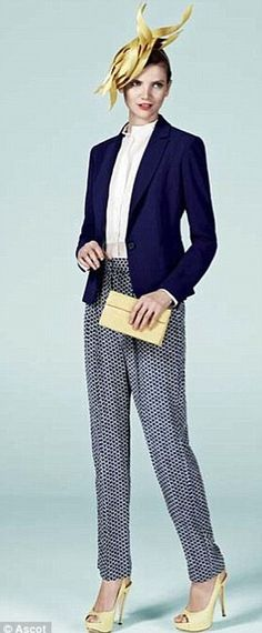 trousers by Gerard Darel, a blue jacket and white shirt by Reiss, shoes by Gina, bag by Nancy Gonzalez and headpiece by Philip Treacy,