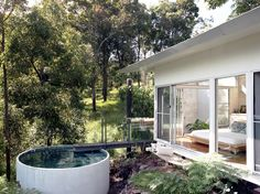 Pool made of a conrete pipe at Mount Ninderry, Queensland, Australia by Sparks Architects