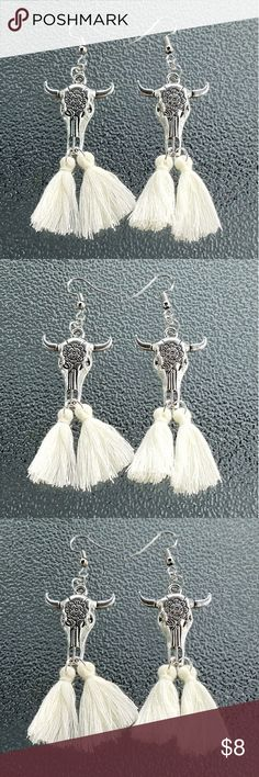 Bull skull earrings, boho earrings, skull earring These are brand-new Bull head earrings the bull head is 1 1/4 inches long and the tassels are 1 1/4 inches long. These tassels are cream colored. These have a cute boho chic or southwest feel.   Bundle any three $8 items and offer me  $16 and I will accept! 😀😀😀😀🍦🍦🍦🍦🍬🍬🍬🍬🍭🍭🍭🍭 Jewelry Earrings