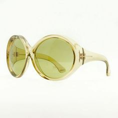 Round sunglasses with a yellow tint