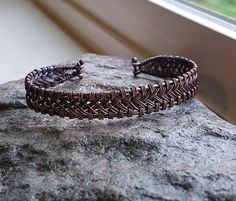 Beautiful pure copper bracelet, hand woven braid secured to 16ga copper frame. Available as a custom order for a limited time. Choose from either a cuff style or hinged clasp in whatever size you need.
