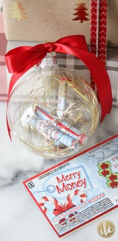 Rolled up lottery tickets make a great Christmas gift idea tucked into a clear holiday ornament - via inspiredbycharm.com