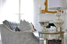 Our Harrison Sofa & Borghese Mirrored End Table adds timeless elegance to this living room. :