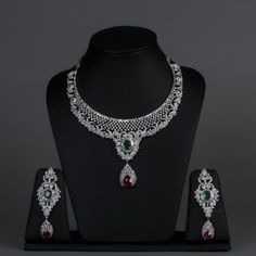 Featuring this american diamond & ruby necklace set with Green Stones in our wide range of Sets. Grab yourself one. Now!