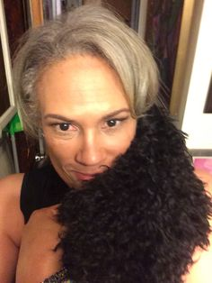 AIDS Activist Rae Lewis-Thornton playing with her poodle puppy Chloe #hiv #aids #divalivingwithaids #poodle #poodlemom