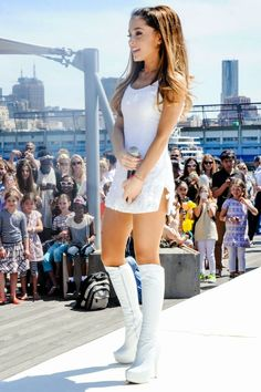 Pop singer Ariana Grande performed at the Born Free Africa Mother's Day Family carnival in New York City, and wore a white mini dress. Ariana Grande Outfits, Ariana Grande Fotos, Ariana Grande Pictures, Adriana Grande, Boots Talon, Foto Portrait, Modelos Fashion, Elegantes Outfit, White Mini Dress