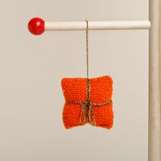 This precious present is an easy DIY ornament to put on your tree!