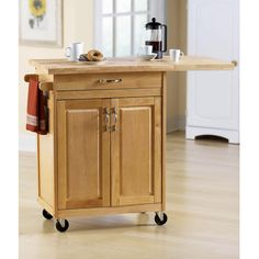 We are looking for a small 'island' for the kitchen that we can stow next to the wall. this looks like it might fit the bill.  It is made out of wood (except the back which could be switched out and replaced with bead-board-- and then paint it all white?) and is only $119.84 at Walmart.  Mainstays Kitchen Island Cart, Natural