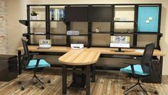 I like this industrial office furniture look for these shared L shaped desks!  The metal frames are great for open & enclosed storage & functional for desk organization.  You can easily add an acoustic tackboard like the one shown in teal here.  The butcher block like style of laminate desk is a nice contrast to the black metal.  Cool stuff for someone interest in metal or steel office furniture.