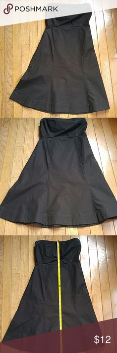 Gap Stretch Strapless Black Sundress Black, strapless sundress from the Gap. From Summer 2004 as shown on tag. 95% cotton, 5% Lycra. Fabric is not super dressy which makes it very functional. Worn twice max. In excellent condition, just some deodorant marks at top which I'm sure would come out in the wash. (Machine washable according to tag, I didn't know the marks were there until taking the pictures).  Size 1, fits like a 0. Approximately 12 inches across bust and 28 inches from top of…