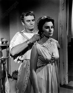 akg-images -The actor Laurence Olivier is tying the necklace to Jean Simmons in a scene from the film Spartacus. 1960.