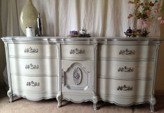 Annie Sloan's Paris Grey Chalk Paint on the body and to the drawers we added a glaze to give it a striae (stripe) effect. Clear and dark wax added a little antique patina and silver paint lines the details. by Vintage Hip Decor