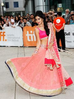"""Shriya Saran looked lovely in a peach and pink combination subtle lehenga in """"Midnight's Children"""" Premiere"""
