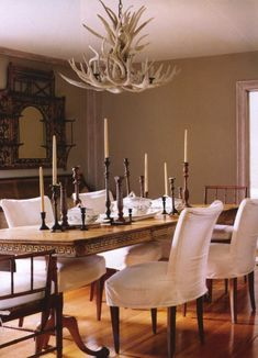 A pine table with a Greek key motif, French chairs upholstered in white loose covers and an antler chandelier make an interesting dining room Brown House, Dark House, French Chairs, Dining Room Table, Dining Rooms, Home Decor Inspiration, Decor Ideas, Room Ideas, Home Hardware