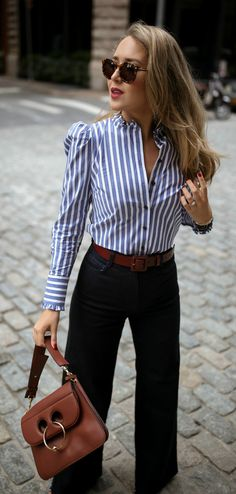 Blue + white stripped button down shirt with puff shoulder & high ruffled neckline, wide-leg retro dark-wash jeans + wide statement brown leather belt, large tortoise shell vintage sunglasses, brown leather satchel bag. Nyc Fashion, Fall Fashion Trends, Work Fashion, Autumn Fashion, Fashion Outfits, Office Outfits, Fall Outfits, Casual Outfits, Office Attire