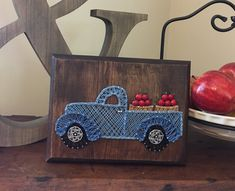Perfect for fall decor! This string art Apple truck measures 7x9 inches and is fully customizable.  Wall mount hanger attached.