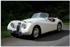 1953 Jaguar XK120 Roadster S661110. Make it hunter green (or black) with cream interior and this is my dream car.