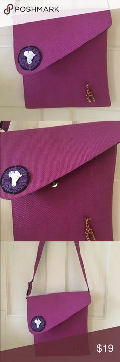 """Fuschia Woven Bag from Africa This bag is fuscia with a wooden giraffe decal and metal disc in the shape of Africa on the front. It's approximately 14@x14"""" and snaps closed. The inside is lined with black fabric and has a small inside side zip pocket. The material is woven and fairly stiff. Bought at a national park in Tanzania. Bags Crossbody Bags"""