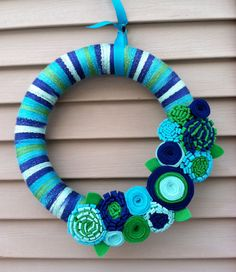 Spring Wreath - Multi-color Spring Yarn Wreath w/ Felt Flowers. Yarn Wreath - Easter Wreath - Spring Decoration - Mother's Day Wreath by stringnthings on Etsy https://www.etsy.com/listing/123167778/spring-wreath-multi-color-spring-yarn