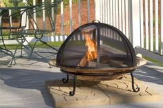 """Good Directions 775 Large Spark Screen for Fire Pit  The Good Directions 775 Large Spark Screen is a powder-coated steel intricately woven mesh spark screen, which offers an added layer of protection to any outdoor fire pit blaze. The hinged spark screen has a convenient handle on top to simply take the screen on and off. The spark screen is 30""""Diameter x 15"""" H; and fits with Good Directions' own large fire pit (SKU #772). Perfect addition to keep backyards and barbecues safe from fl.."""