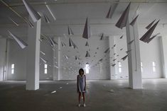 "Artist Dawn Ng created this incredible art installation involving thousands of paper planes. Titled ""I Fly Like Paper,"" planes are seen bursting through a small window, and into a massive indoor exhibition space."