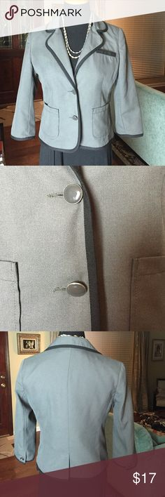 """Double-Button Blazer w/Black Trim from Old Navy Classic and cute little blazer from Old Navy in a charcoal gray with black trim. Fully lined. The shell is 65% polyester and 35% viscose. The lining is 100% polyester. Dry cleaning recommended. 4"""" slit in back. There is very minor scratching on the buttons but it is not noticeable and less you are inspecting them very closely. Each sleeve has one button closure so these can easily be rolled up if you chose to. Blazer only, dress and necklace…"""